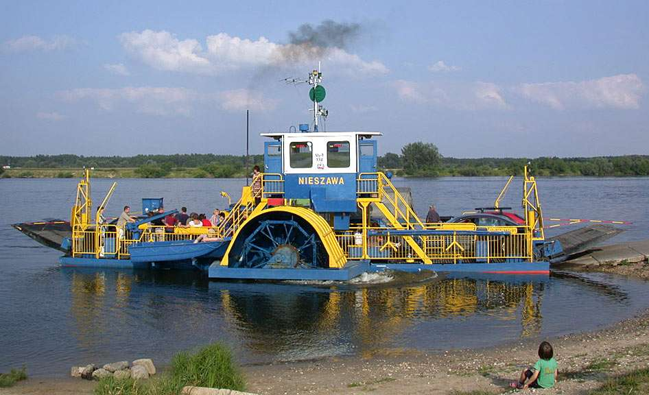 Ferry in Nieszawa (Poland) - Crossing Vistula River in Nieszawa (Poland). A ferry in Nieszawa with side paddle wheel is the only such a ferry in Poland. People have been crossing Vistula River since centuries. However, the first (11×6)