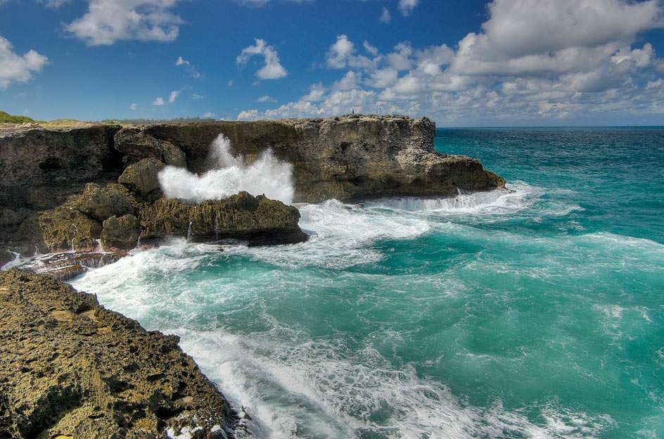 North Point Cliffs - Barbados - The scenic view from North Point over the cliffs. The North Coast of Barbados  faces the Atlantic Ocean, where huge waves crash along the shore and coral reefs (8×6)