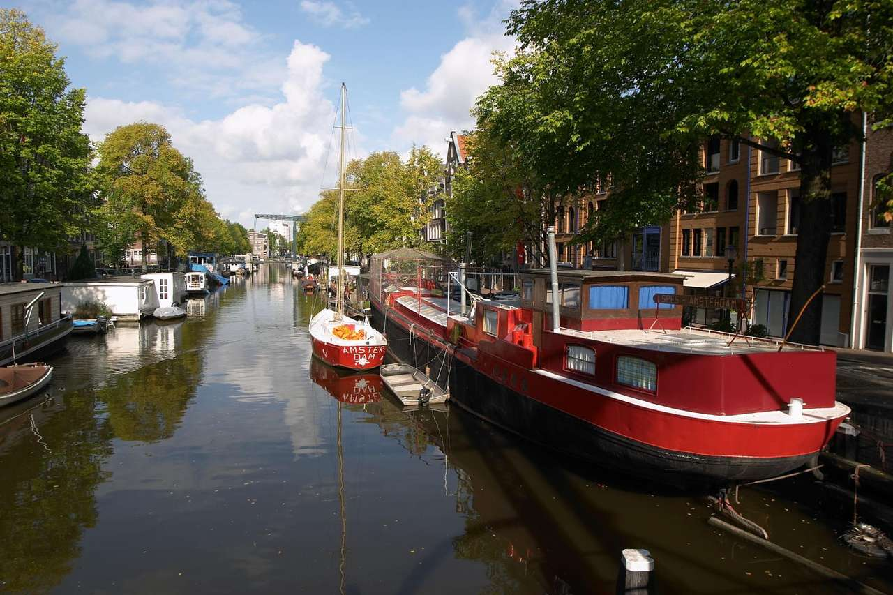 Canal in Amsterdam (Netherlands) - Amsterdam is the capital and largest city of the Netherlands. It is often called Venice of The North, because of its over hundred kilometers of canals, 90 islands and 1500 bridges. The three main cana (12×8)