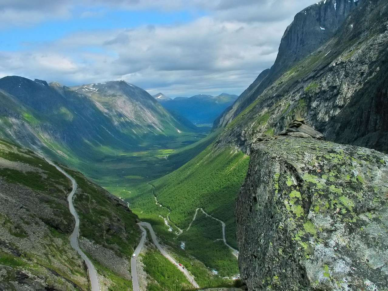 Isterdalen Valley and Trollstigen (Norway) - Trollstigen (means Troll Ladder) is a picturesque, mountain road connecting Isterdalen Valley and Valldal Valley in Norway. Road's steep incline is 9%. It is a popular tourist attraction due to eleven (11×8)