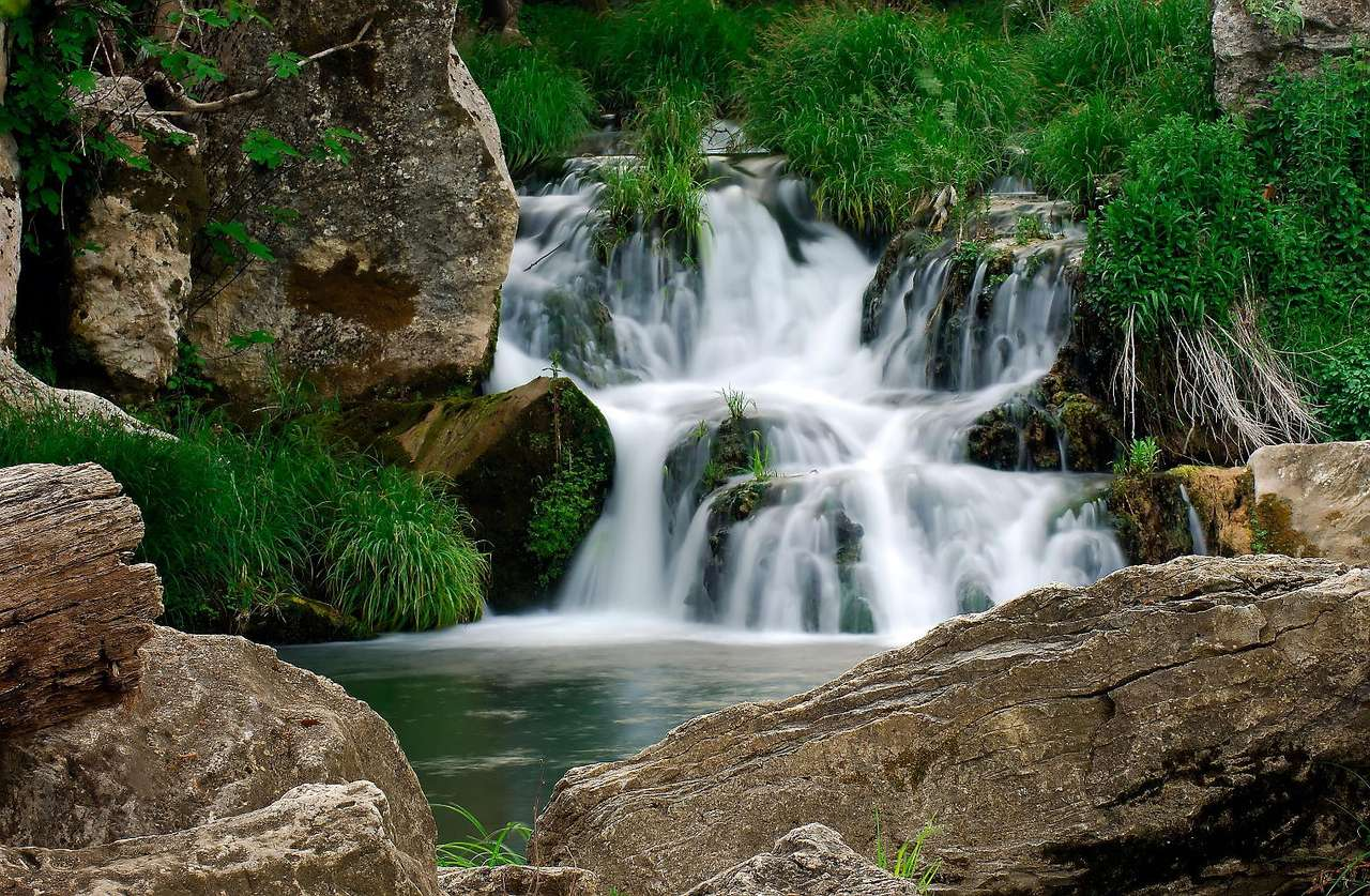 Small waterfall - The hum of falling water encourages you to rest. It is hard to resist, especially in a hot day, when it is nice to feel pleasant chillness of the waterfall (10×7)