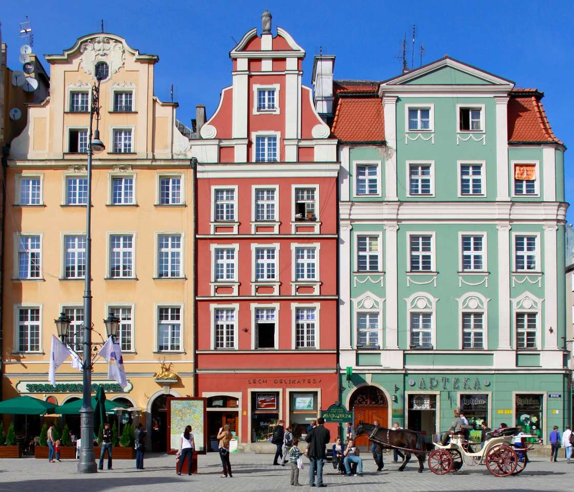 Tenements houses in Wroclaw (Poland) - Wroclaw may pride itself on one of the biggest old town markets in Europe. It was established between 1214 and 1232, during the reign of Henry I the Bearded. The market is surrounded by buildings, whi (10×7)