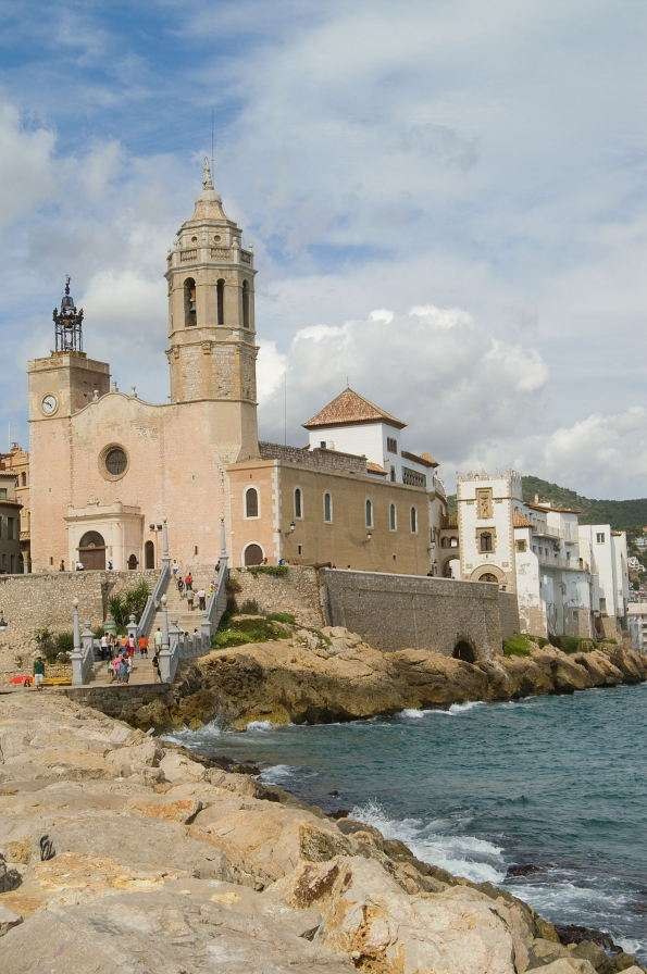 Church in Sitges (Spain) - Sitges is a small town and a seaside resort in Spain, located near Barcelona. The most beautiful historic building of Sitges is the St. Bartholomew and St. Thecla church. The church was built in 17th (5×8)