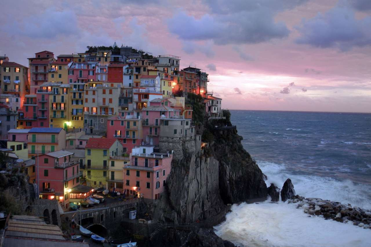 Panorama of Manarola (Italy) - Manarola is a town in northern Italy, which is often visited by tourists. The town was built as early as in 14th century. Manarola has a specific small architecture: all residential houses are colorfu (8×5)