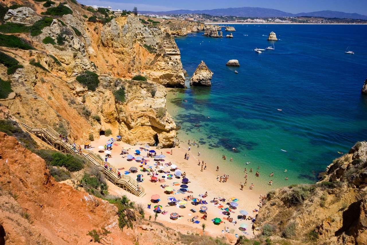 Rock Algarve Coast (Portugal) - Rock Algarve is a hilly coastline in Portugal with fertile valleys and clean, warm beaches. In the cliff coastline one may find many grottos and caves sculptured by water in limestone. The Rock Algarv (16×10)