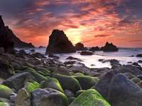 Sunset over the Ursa rocky beach (Portugal)