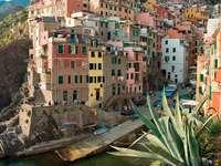Buildings on the scarp in Riomaggiore (Italy)