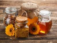Jars of honey and propolis