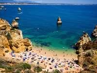 Beach between rocks in Algarve (Portugal)