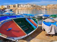 Boats with the view on the port in Gallipoli (Italy)