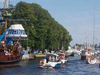 Ships and yachts entering the port in Darłowo (Poland)