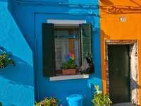 Facades of colorful house in Burano (Italy)
