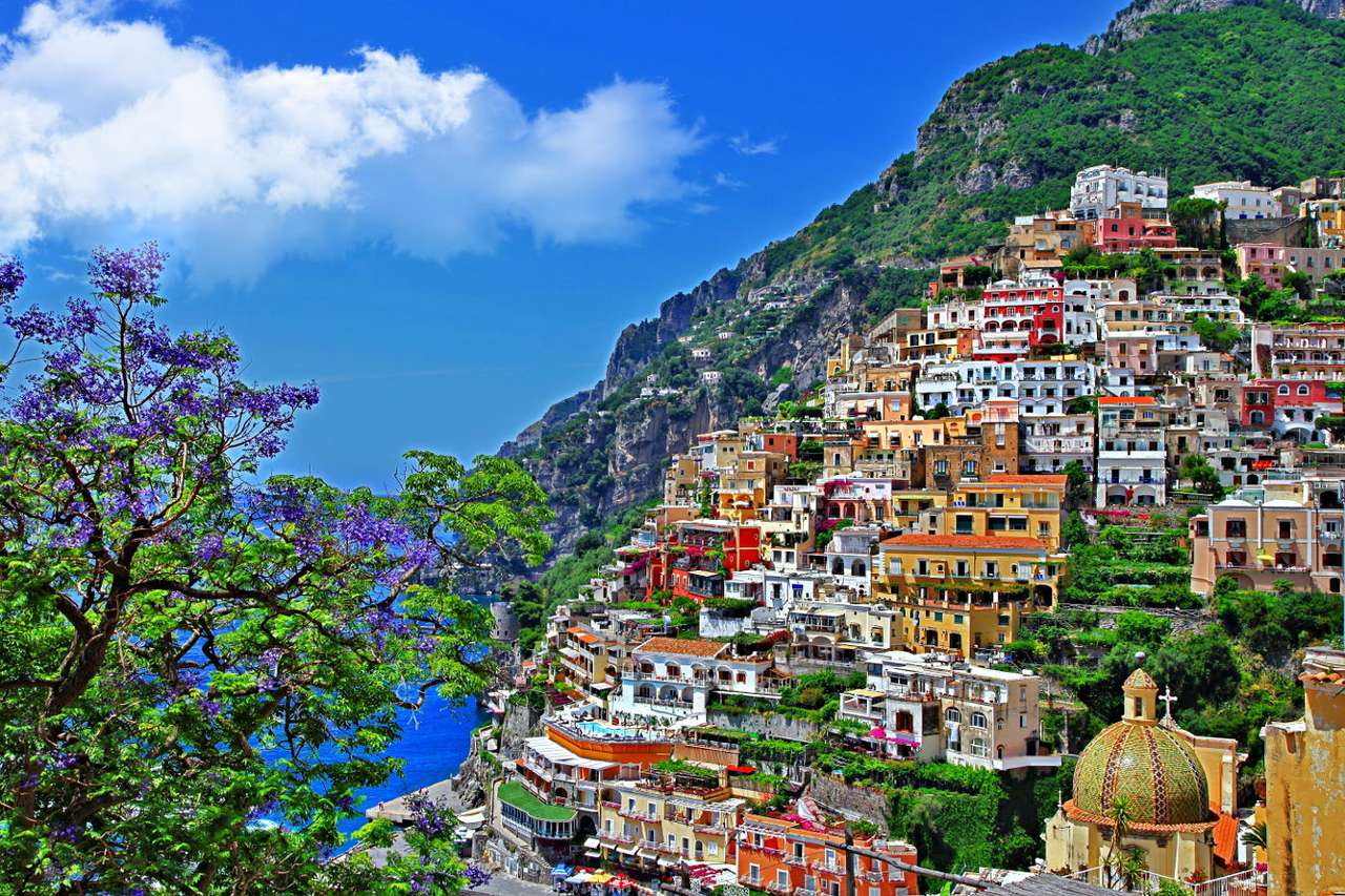 Positano (Italy) - Beautiful town of Positano is located on two picturesque cliffs on the Tyrrhenian Sea. Colorful facades of houses are characteristic for this town located on the coast of Amalfi. The houses create a u (9×6)