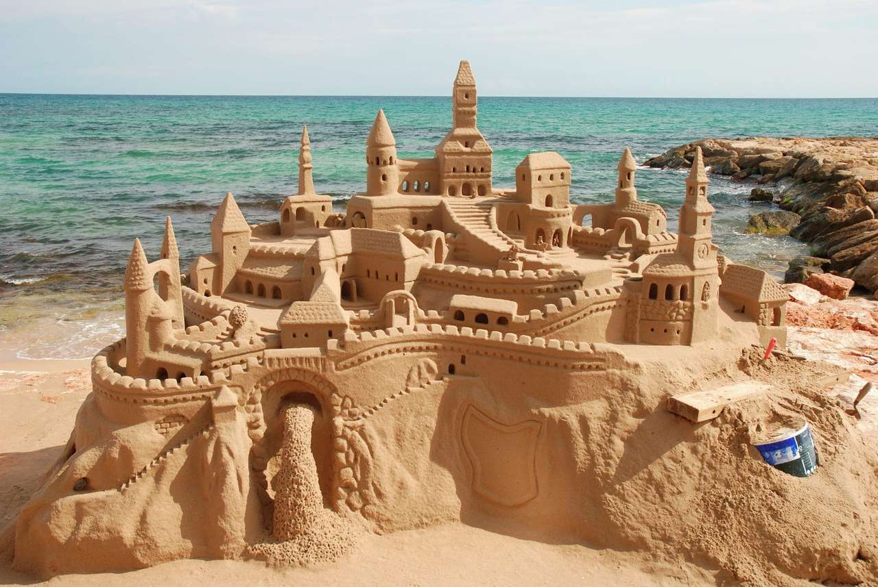 Sand castle - Building sand castles is a popular pastime at the beach. Children build their sand strongholds with the use of sand buckets, shovel and a bit of sea water. The fun that accompanies their creation is m (8×5)