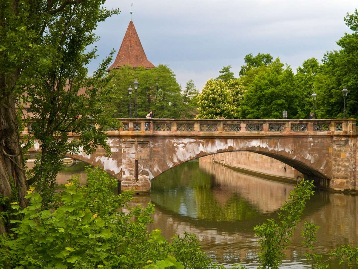 Old bridge in Nuremberg (Germany) - Nuremberg is located in Bavaria - the German federal state. The city is situated on the river Pegnitz. Nuremberg is famous for its beautiful sights, which include the Renaissance city hall, the 13th-c (8×6)