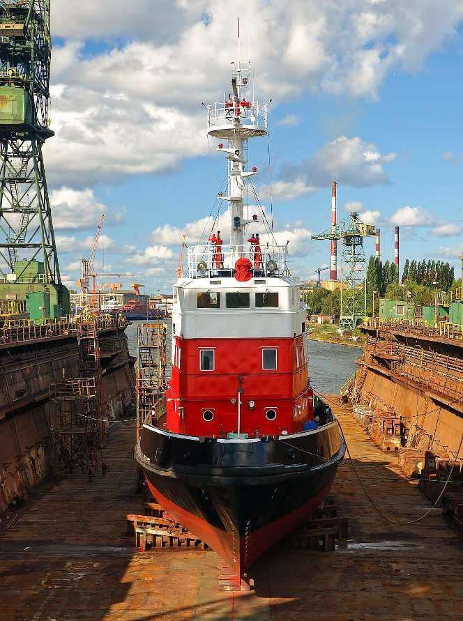 Boat  in the dock of Gdańsk Shipyard - Gdańsk Shipyard is the most famous business of this type of in Poland. It was founded in 1804 on the left bank of the Martwa Wisła (literally: Dead Vistula). Large merchant seagoing ships had been b (8×11)