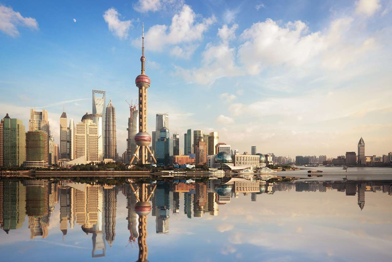 Panorama of Shanghai reflected in the surface of water (China) - Shanghai is the largest and fastest growing city in China. This seaport is located in the east of the country and can boast the largest skyscrapers, the world's largest underground network and a huge (8×5)