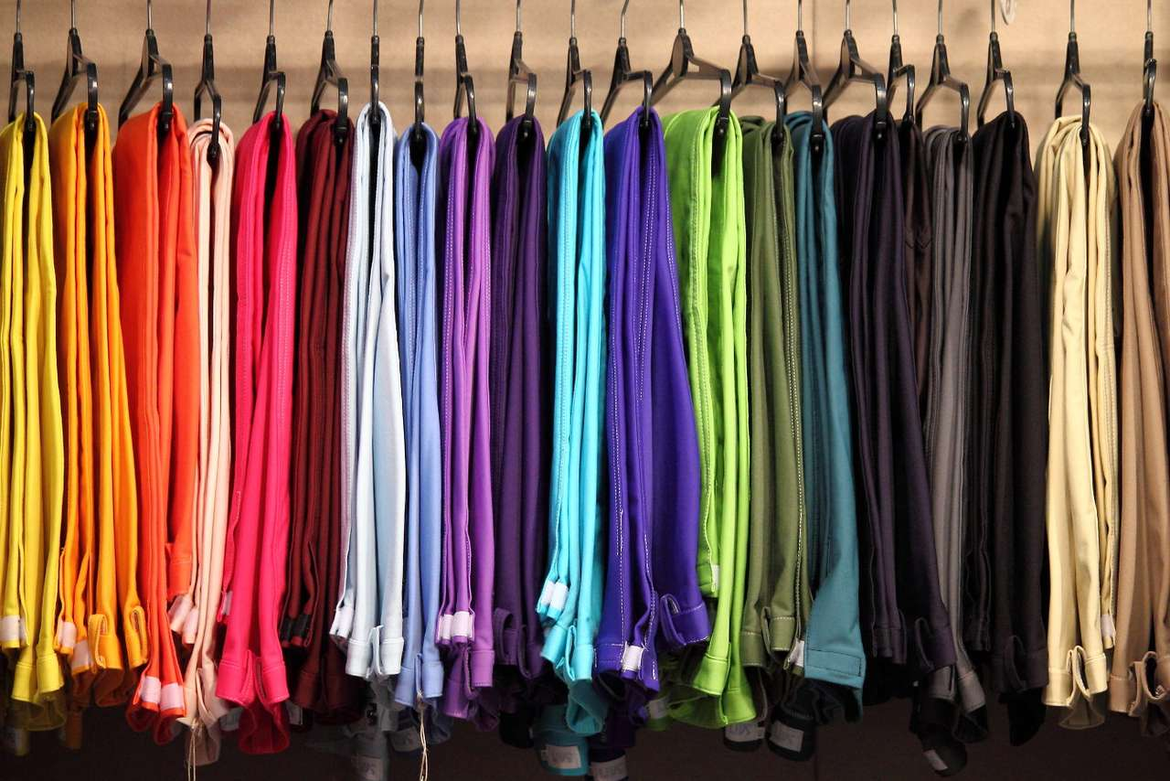 Hangers with colorful trousers - The history of trousers dates back to the beginning of our era, however, they initially looked like pantyhose as they also covered feet. Then hoses were introduced that enshrouded each leg separately, (21×13)