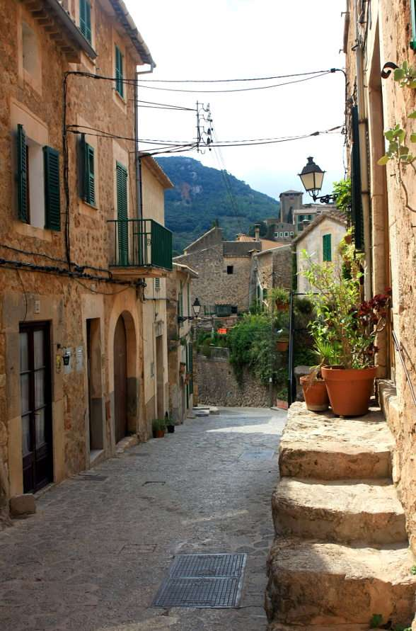 Street in the village of Valldemossa (Spain) - Valldemossa is a picturesque Spanish village situated among the mountains on the Mediterranean island of Mallorca. The history of the village dates back to the 14th century when the king of Mallorca, (7×11)