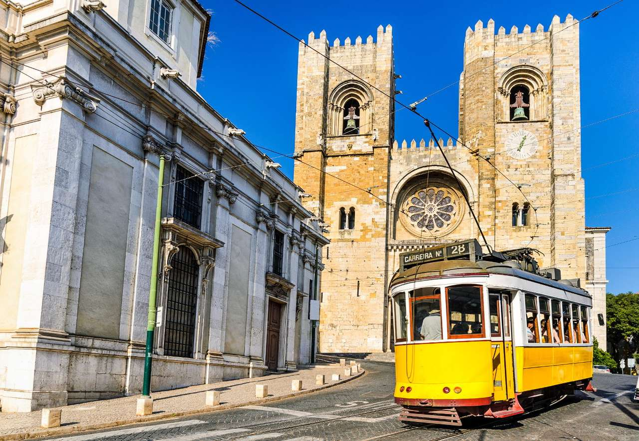 Yellow tram in Lisbon (Portugal) - Yellow trams are one of the most popular tourist attractions of Lisbon. The historic trams have been operating in the old neighborhoods of the city for years. They offer passengers not only a nice rid (9×6)