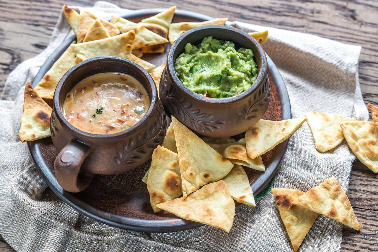 Nachos with cheddar and guacamole - Guacamole is a popular Mexican sauce based on avocado with lime and salt. It can be served as a standalone appetizer or additive for nachos, i.e. small, usually triangular tortillas. This crunchy snac (11×8)
