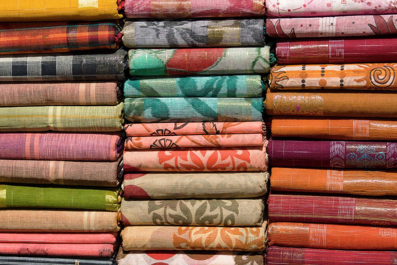 Colorful fabrics at the bazaar in India - The increasing interest of tourist in products of local artists make traditional handicrafts in many regions of the world back into favor. When going on vacation to an exotic country, every tourist dr (15×15)