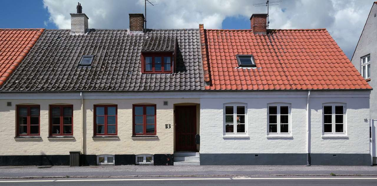 Houses in Nexø (Denmark) - Nexø is a small fishing town located on the Danish island of Bornholm. The port was built on a sandstone rock. This building material that has been extracted from the quarry north of the town since t (15×6)