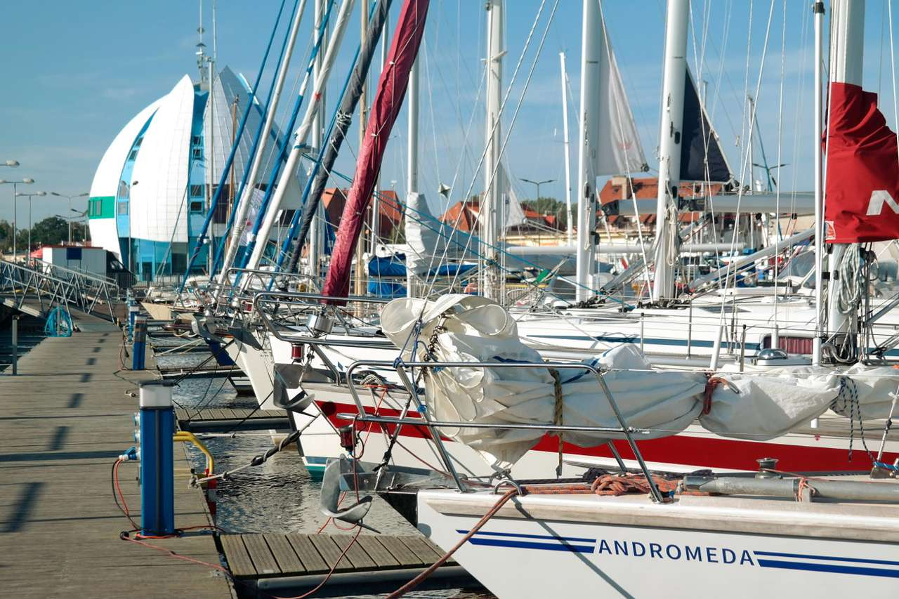 Marina in Hel (Poland) - Hel is a small town at the easternmost tip of the Hel Peninsula. There are a war port, fishing harbor, marina and a bathing beach. The marina in Hel is equipped with floating bridges where crafts up t (12×8)