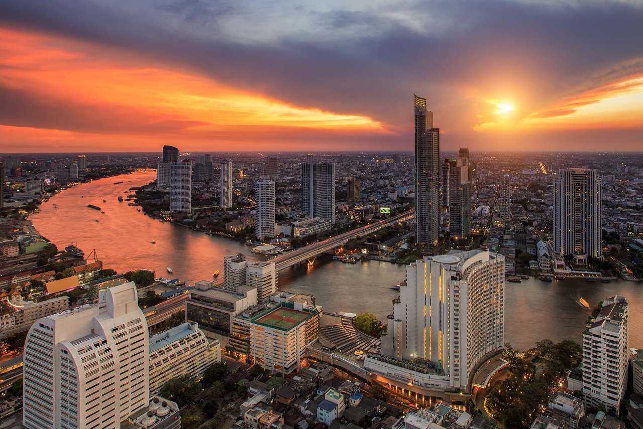 Panorama of Bangkok with the Chao Phraya River (Thailand) - Bangkok is a large Thai city on the Chao Phraya River. The capital of Thailand combines tradition and modernity. In some parts of the city ravishing palaces and temples give way to residential buildin (11×7)