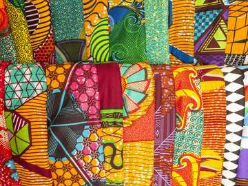 Traditional African fabrics at a market stall in Ghana
