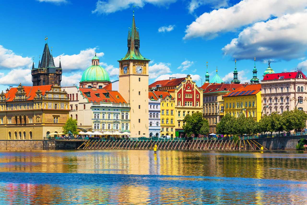 Panorama of Prague on the river Vltava (Czech Republic) - Prague is the capital of the Czech Republic and one of the most beautiful places in Europe.  The river Vltava flows through the city – it is the left tributary of the river Elbe and also the longest (10×7)