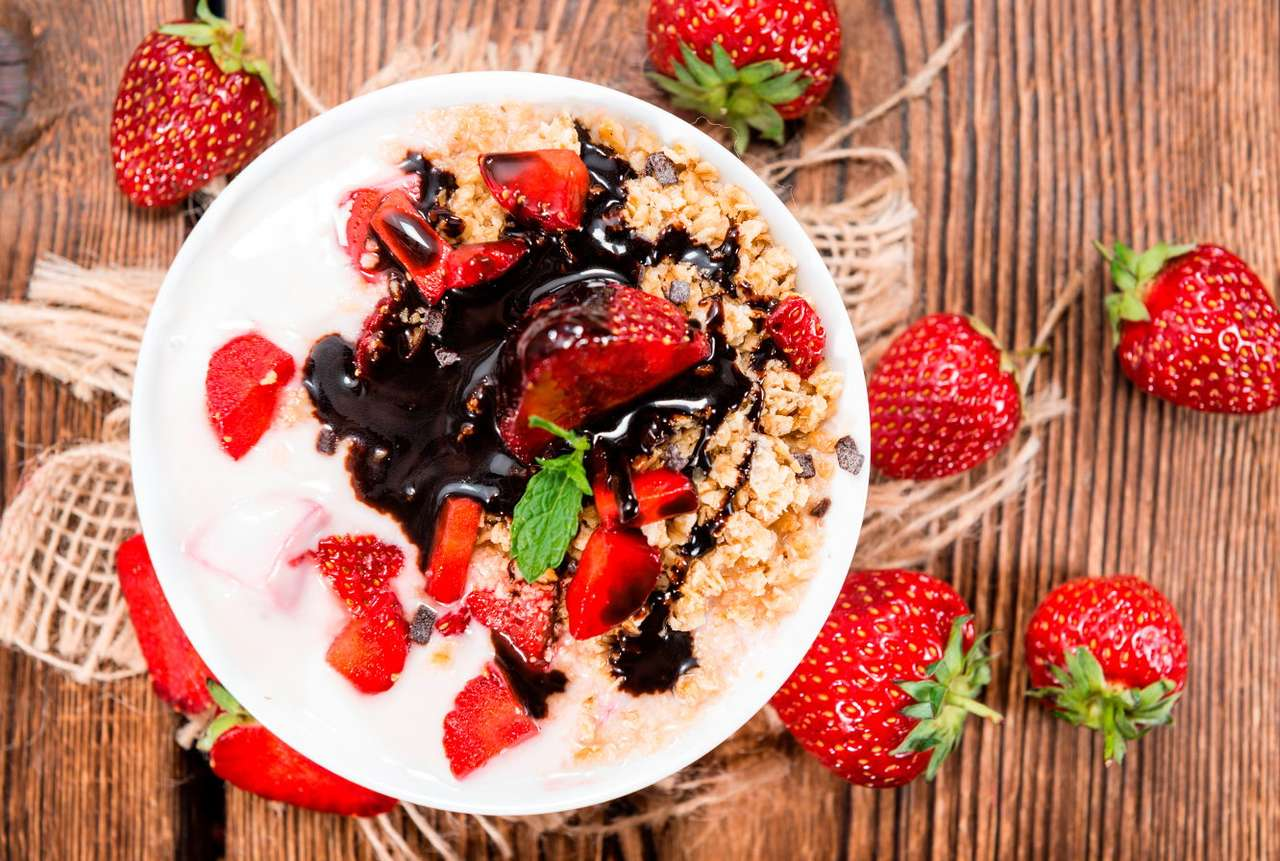 Dessert of ripe strawberries - Strawberries are a delicious and healthy fruit, which tastes best in summer. They are perfect with dairy products, therefore they may be a basis of a self-prepared dessert. Pieces of ripe fruit served (12×8)
