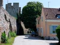 Street along defensive walls in Visby (Sweden)