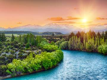 Sunset on the Clutha River at the foot of the Southern Alps (New Zealand)