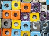 A wall of colorful bricks