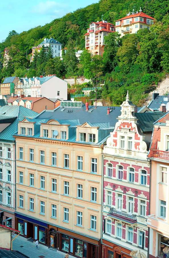 Old Town of Karlovy Vary (Czech Republic) - Karlovy Vary is a large spa in the western part of the Czech Republic. The town is located on the confluence of as many as four rivers. Its location at the foot of mountain peaks attracts tourists and (8×12)