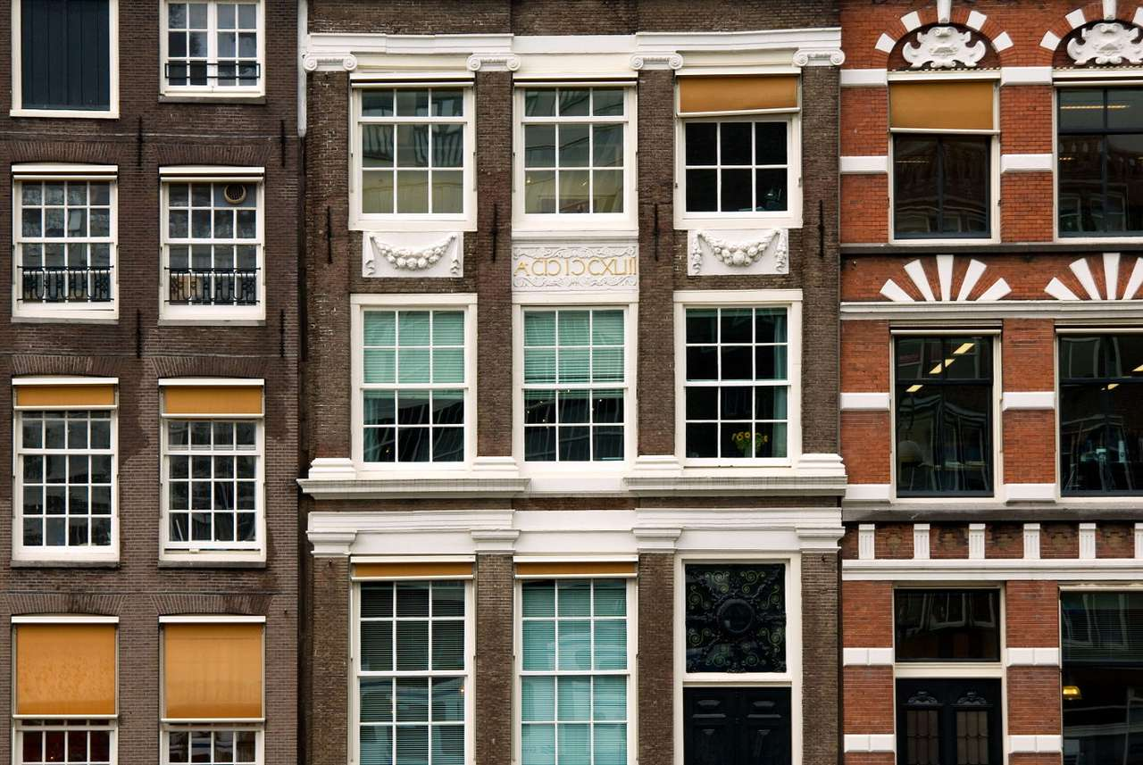 Close-up of the facades of merchant houses in Amsterdam (Netherlands) - Amsterdam is the largest port in the Netherlands and one of the largest ports in the world. The city has been one of the most important commercial centers on the map of Europe since the 16th century (20×13)