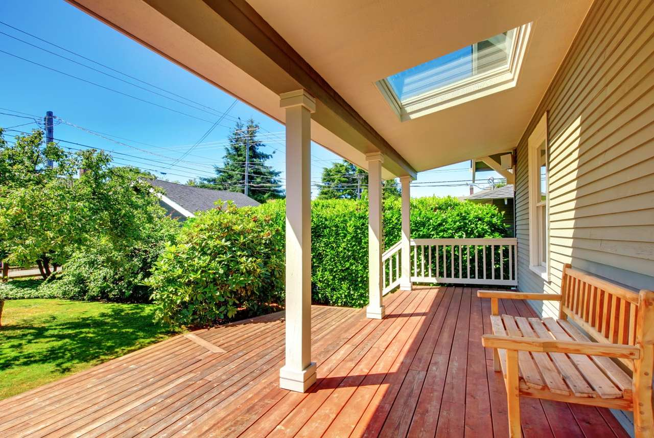 Spacious wooden veranda - A roofed, wooden porch with a comfortable bench is a perfect place to spend a summer afternoon with a cup of coffee and book. Parents relaxing in the shade of a spacious veranda can watch children pla (14×9)