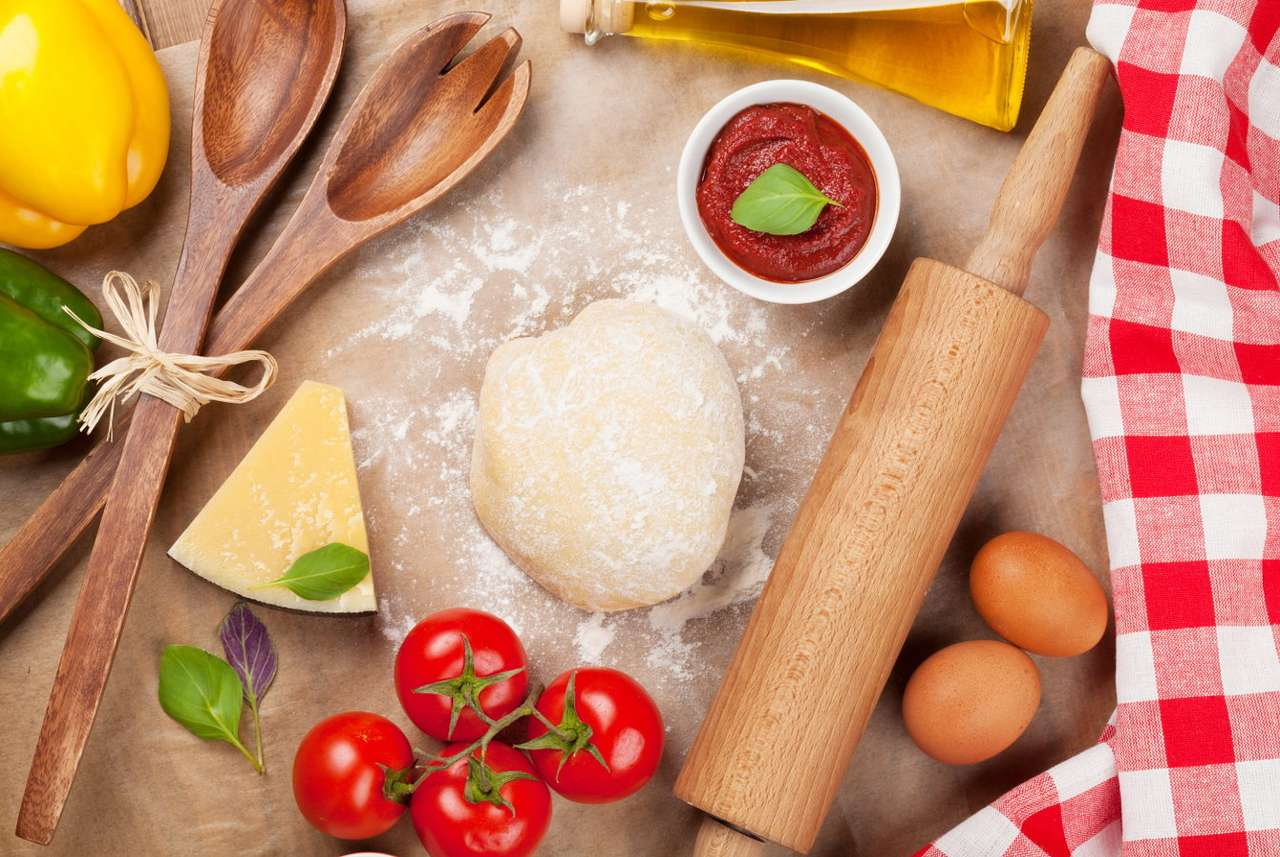 Raw pizza dough - Pizza is one of the most popular dishes in the world and the universality of its prevalence almost everywhere in the world can give rise to the belief that it is a dish easy to prepare. The preparatio (12×9)