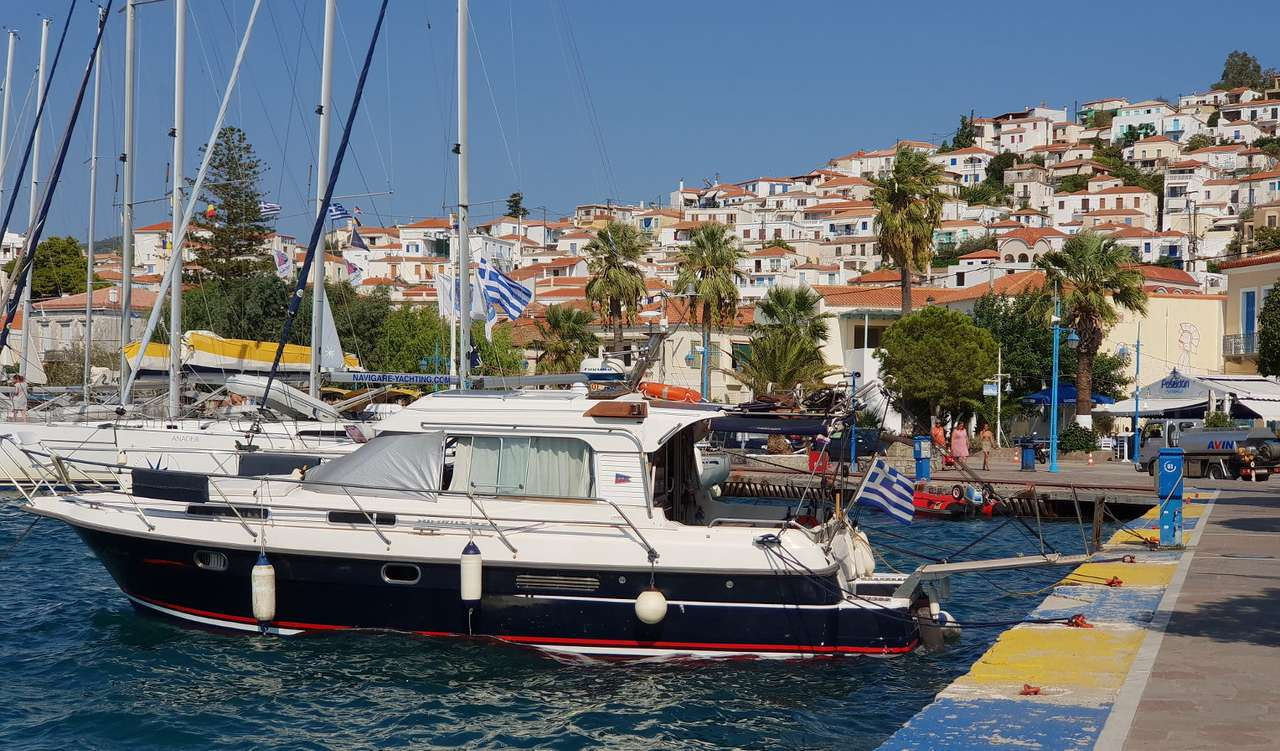 Yachts at the marina in Poros (Greece) - Poros is one of the Saronic Islands located in the Greek Attica. The island can be reached from the small town of Galatas on the Peloponnese or the port of Piraeus, which belongs to the Athens agglome (8×7)