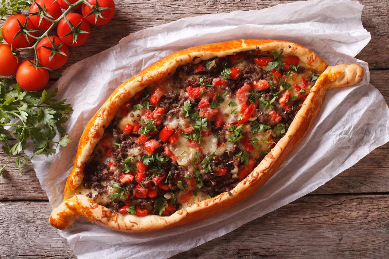 Georgian khachapuri with meat and vegetables - Khachapuri is a dish of traditional Georgian cuisine, which occurs in several varieties. The basis of this dish is a wheat cake with stuffing. In some regions it is prepared from two pancakes filled w (12×7)