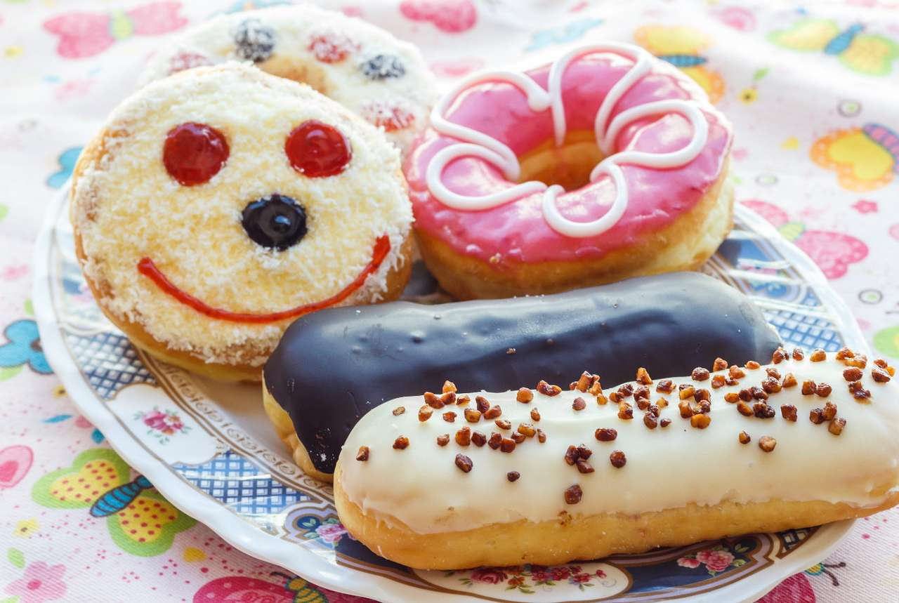 Donuts and éclairs - Donuts are delicious yeast products fried in deep fat. They are formed into slightly flattened balls with fruit or chocolate filling. Donuts with a hole in the middle are an exception. The popularity (16×11)