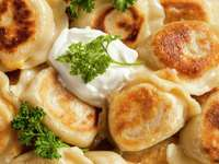 Traditional Polish dumplings served with sour cream