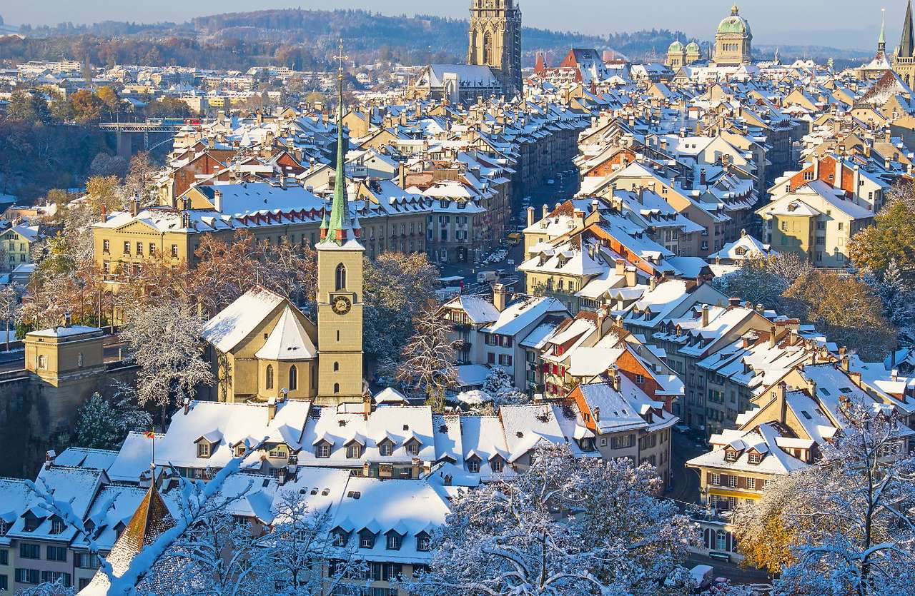 """Snow-covered Bern (Switzerland) - Bern lies at the two sides of the river Aare. The name of this Swiss city comes probably from the word """"bear"""", an animal that is also found in the coat of arms of Bern. The old town has preserved its (15×10)"""