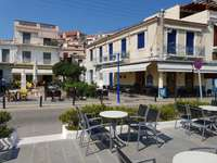 Square with cafes in Poros (Greece)