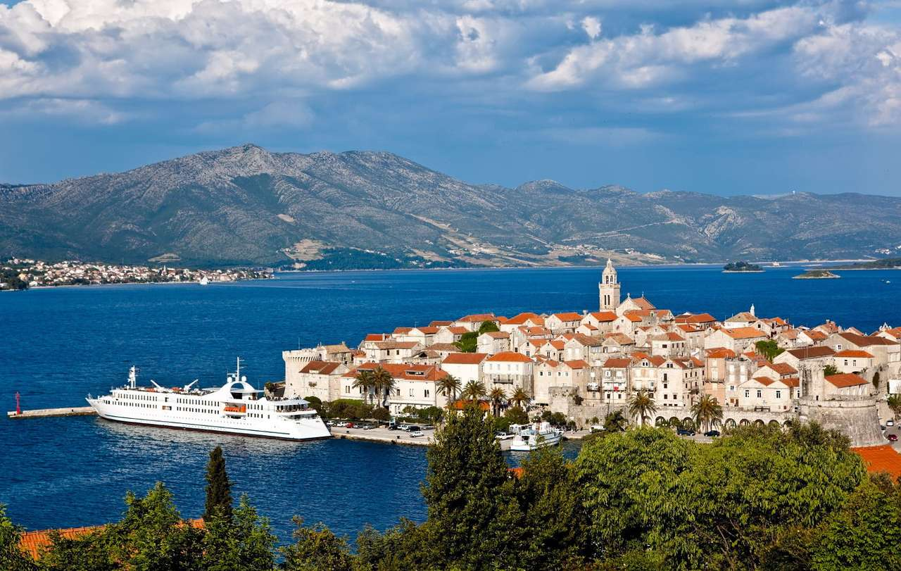 The town of Korčula (Croatia) - The Croatian island of Korčula lies in southern Dalmatia, on the Adriatic Sea. A port town of the same name is situated on its north-eastern coast. The shape of the old town of Korcula resembles the (10×6)
