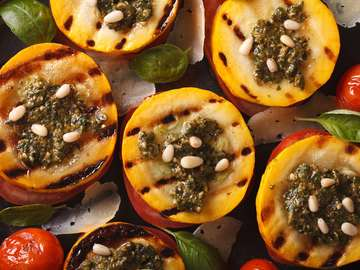 Grilled yellow zucchini with pesto and nuts
