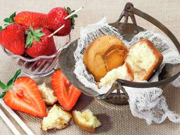 Fresh strawberries and muffins in a metal bowl
