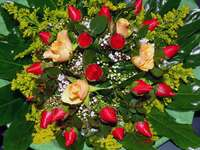 Bouquet of red and cream roses