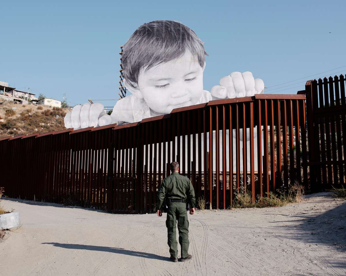 Mexican Child Over the Border Wall